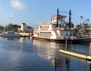 Riverboat next to PDQ 34 Power catamaran