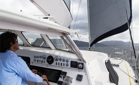 the protected helm aboard the Antares catamaran protects you from the weather