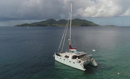 Blue catamaran sailing